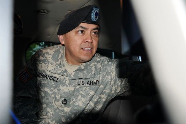 FORT BELVOIR, Virginia - Sgt. 1st Class Alberto Hernandez, information technology specialist, Defense Coordinating Element, Region III (Philadelphia, Pa.), U.S. Army North, sets up an Emergency Response Vehicle at the 2010 Joint Force Land Component Command Interagency Hurricane Rehearsal of Concept exercise at Fort Belvoir, Va., April 28. The vehicle will provide Internet, voice and video teleconferencing capability to the participants of the exercise just as it could in an actual emergency response.