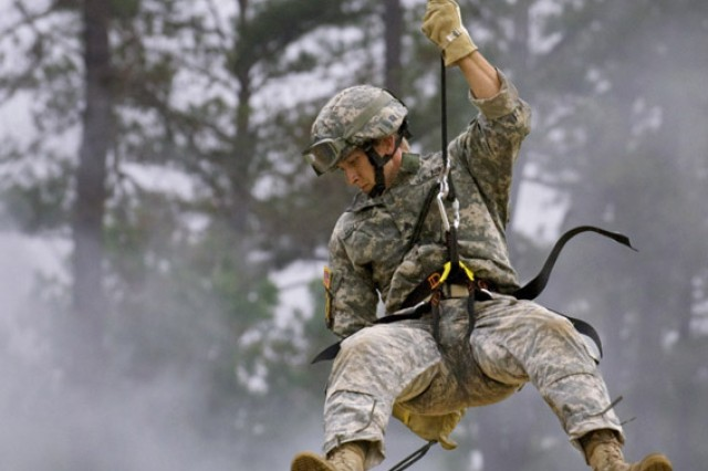 Sgt. Michael Malchow, 75th Ranger Regiment, rappels down the side of the Prusik Climb tower during day two of the Best Ranger competition at Fort Benning, Ga.