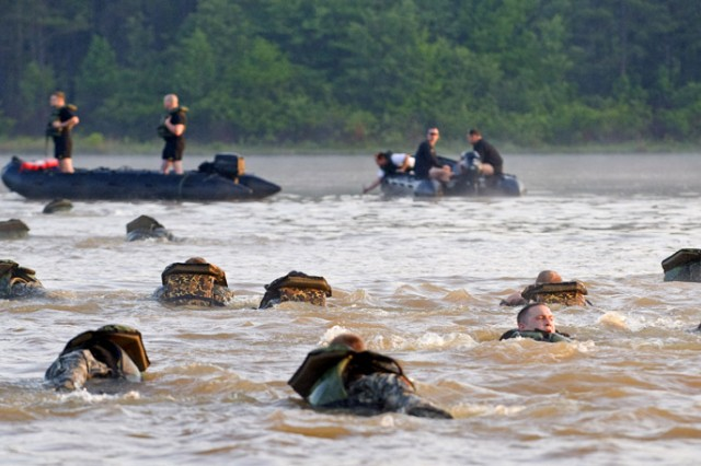 Teams swim across Victory Pond as part of the Buddy Run to start a three-day, non-stop Best Ranger competition at Fort Benning, Ga. Of the 40 teams beginning the event, only 25 were there at the end.