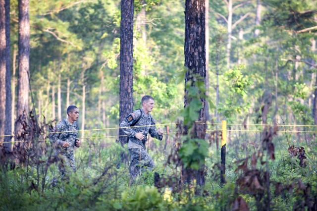 Sgt. 1st Class Jose Magana and Staff Sgt. Thomas West, a team from the 6th Ranger Battalion, run between events during the 2010 Best Ranger competition at Fort Benning, Ga. The team placed 13th overall.