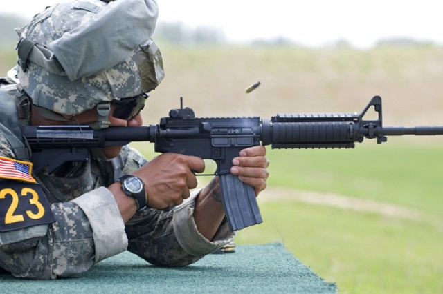 Staff Sgt. Eugene Mirador, a Ranger with the 75th Ranger Regiment, fires downrange during the moving target event of the 2010 Best Ranger competition. The teams competed in three shooting events during the second day of the competition.