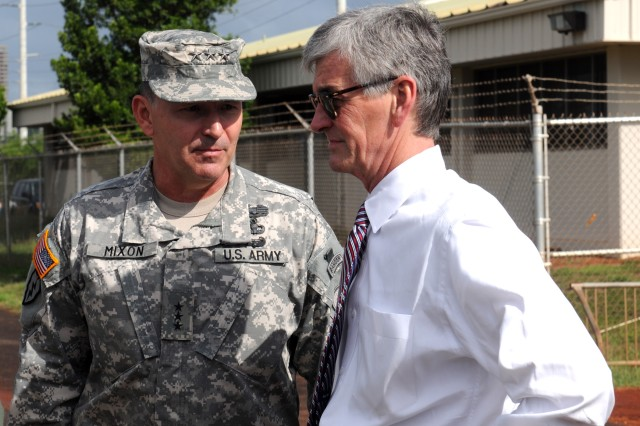 Lt. Gen. Benjamin R. Mixon greets Secretary of the Army John McHugh at Fort Shafter Flats, Hawaii.  Mixon led McHugh on a tour of Schofield Barracks and the Makua Military Reservation in Oahu.