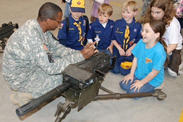A Soldier with 2-2nd Avn., 2nd CAB introduces and explains the MK-19 grenade launcher to children during Boy Scouts night held April 20 at K-16 Air Base.