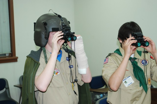 Two Boy Scouts from the Troop 88 from Yongsan experiment with aviation Night Vision Goggles during 'Boy Scouts Night' at K-16 Air Base on April 20. Cub Scout pack 89 was also invited, along with their Family members.