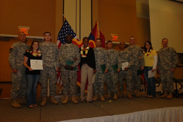 Maj. Gen. Bernard S. Champoux (far right), commanding general, 25th Infantry Division, CSM Anthony Marrero (far left), 3rd Brigade Combat Team, stand with 6 reenlisted Soldiers and their family members following a retention ceremony April 21 at the Nehelani Banquet and Conference Center, Schofield Barracks, Hawaii.