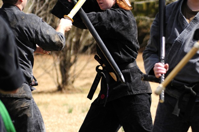 Chaplain (Capt.) Melissa Hale practices the martial art of Bujinkan Budo Taijutsu in her backyard in Smithfield, N.C.