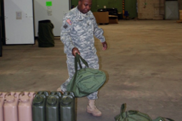 Sgt. 1st Class Wiley Robinson organizes inventory for the 405th Army Field Support Brigade's participation in Exercise Austere Challenge '10.