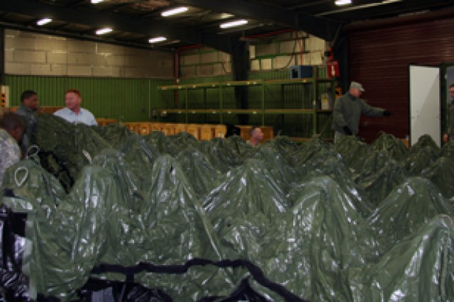 Members of the 405th Army Field Support Brigade prepare a Deployable Rapid Assembly Shelter for deployment to Exercise Austere Challenge '10 in Germany.