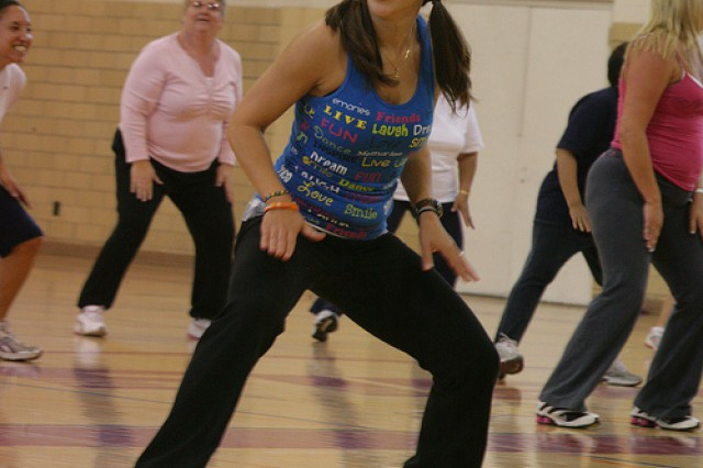 Diana Faulk, certified Zumba instructor, leads a class through some dance moves May 3 at Honeycutt Fitness Center at Fort Sill. The class meets often throughout the week at Honeycutt and Rinehart Fitness centers.