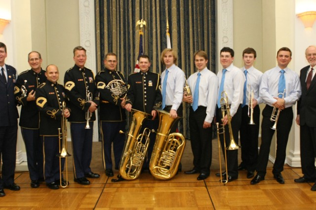 The U.S. Army Band's Brass Quintet and Russian Quintet pose for photos with the U.S. Ambassador to Russia, John Beyrle (far right), and Brig. Gen. Daniel Eagle, Defense Attache (far left).