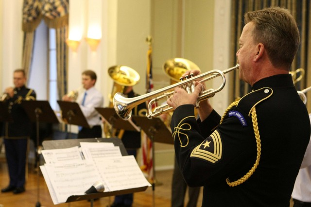 Sgt. Maj. Woodrow English (right), trumpet, plays during a concert.