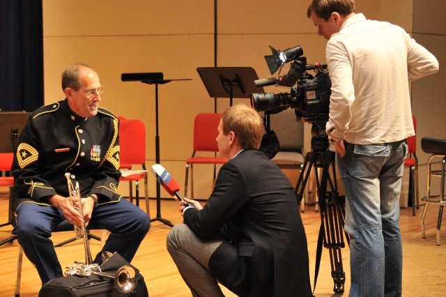 Sgt. Maj. Dennis Edelbrock is interviewed by RTR during a rehearsal prior to the quintet's departure at Brucker Hall, Ft. Myer, VA.