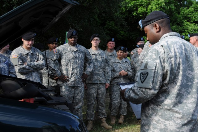 Sgt. 1st Class Robert White, B Co., 1st Bn., 11th Avn. Regt., briefs Soldiers on conducting privately owned vehicle inspections before traveling during a safety stand down day May 10 outside the Fort Rucker Main Post Chapel.