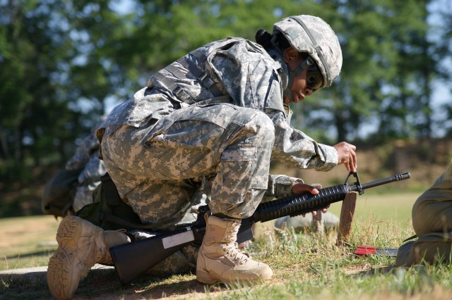 """Staff Sgt. Tania DeJesus, 106th SB, Fort Sam Houston, Tex., zeros her M-16's sight while competing at a range during the 7th Signal Command (Theater) Soldier of the Year completion held at Fort Gordon, Ga. recently. Staff Sgt. Lynna Revard, 93rd Signal Brigade, Fort Eustis, Va., earned the honor of 7th SC (T) NCO of the Year and Spc. Brittany Williams, CONUS-Theater Network Operations and Security Center, Fort Huachuca, Az., took top honor as the SOY. Staff Sgt. Angela Field CONUS-TNOSC and Spc. Paul Richardson, South-TNOSC, Fort Gordon, Ga., earned the NCO and SOY runners up honors respectively. """"These warriors excelled at a broad range of skills and demonstrated their vast knowledge during a grueling week of individual competition and team building,"""" said BG Jennifer L. Napper, 7th SC (T) commanding general. """"They represent the extremely capable and highly motivated Soldiers who will lead our force and keep us Army Strong into future as we meet the nation's challenges around the globe."""""""