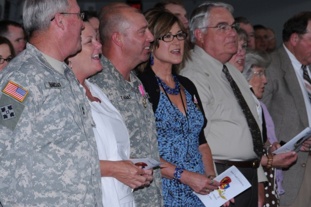 Maj. Gen. James O. Barclay III, USAACE and Fort Rucker commanding general; his wife, Deborah; Brig. Gen. Kelly J. Thomas, USAACE and Fort Rucker deputy commanding general; and his wife, Sue, sing the Aviation Branch song during Thomas' Honor Eagle May 10.