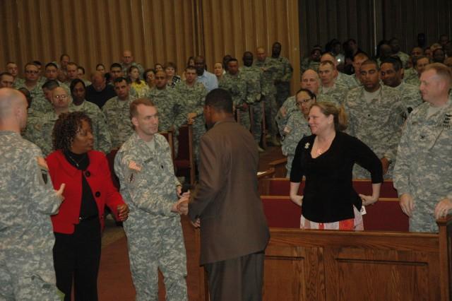 (Fort Stewart, Ga.) Herschel Walker with LTC Bill Reitemeyer, commander, Warrior Transition Battalion following Walker's presentation to the Fort Stewart Community May 13 in the Main Post Chapel.