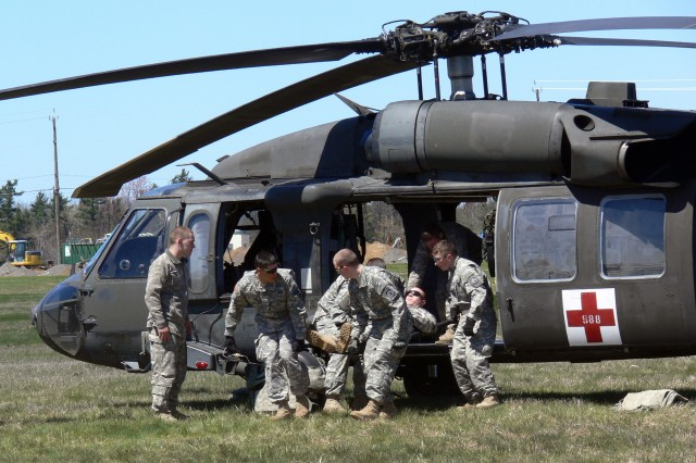 Soldiers of 511th Military Police Company conduct static load training in a UH-60 Blackhawk on April 27. Training consisted of getting each group of Soldiers to load and unload casualties as quickly as possible.