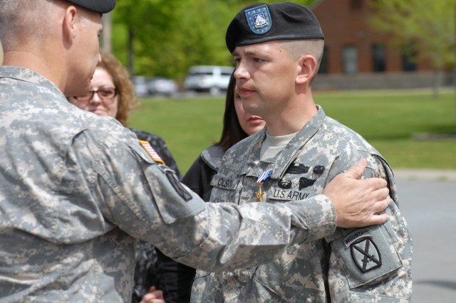 Sgt. 1st Class Richard J. Olson Jr., platoon sergeant for 2nd Platoon, Company B, 2nd Battalion, 87th Infantry Regiment, receives the Silver Star from Maj. Gen. James l. Terry, 10th Mountain Division (LI) and Fort Drum commander, May 7 for distinguishing himself in combat