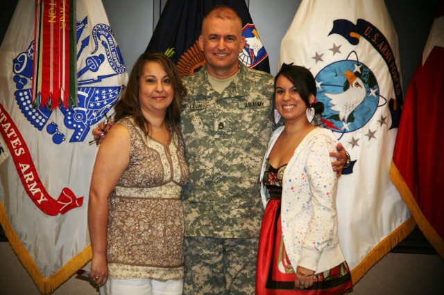 Staff Sgt. Jerry De LeAfA3n, a native of Puerto Rico, poses with his wife Janette and his daughter Janery after his reenlistment ceremony May 10 on Redstone Arsenal, Ala.
