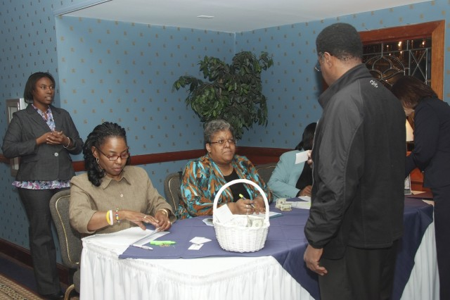 Haiti Relief Effort Luncheon committee members check-in participants at Gibbs Hall.