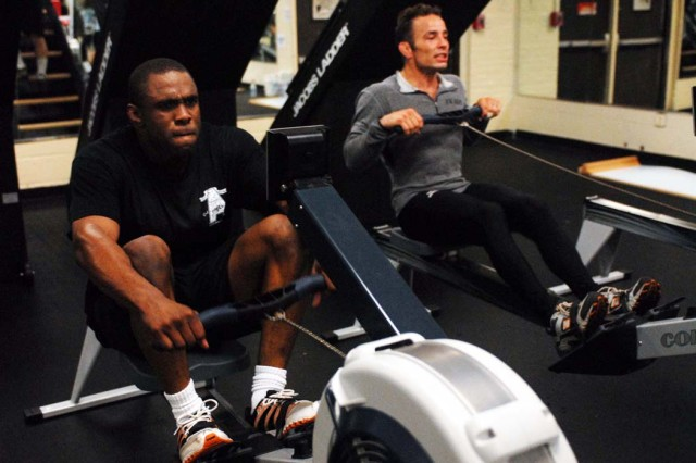 WCAP wrestlers James Johnson and Glenn Garrison exercise on row machines May 4 at the Audie Murphy Athletic Performance Enhancement Center.  The team stopped at Fort Benning from May 4-10 to train for the 2010 World Team Trials, which will be June 10-12 in Council Bluffs, Iowa.