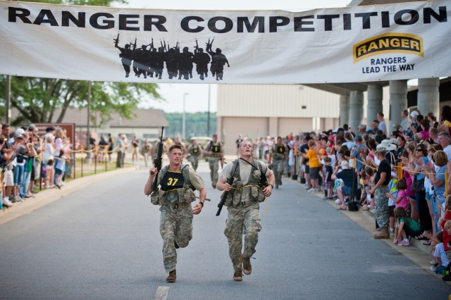 Capt. Derrick Anderson (left) and Staff Sgt. Chris Malone, of the 3d U.S. Infantry Regiment known as the Old Guard, cross the Best Ranger Competition finish line, May 9 after completing three long days of competitive events.