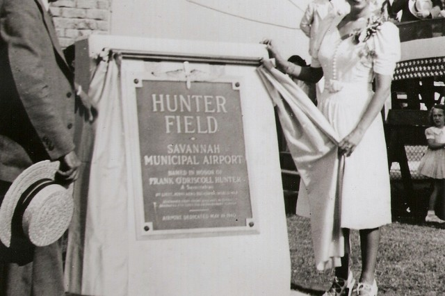 "Jeanne Hunter, sister of then Col. Frank O'Driscoll ""Monk"" Hunter, unveils a plaque at the dedication ceremony of Hunter Field on May,19, 1940. Hunter Army Airfield was named after Hunter in 1940."