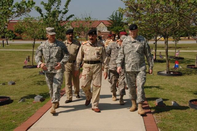 Brigadier General Thomas Vandal, 3rd ID deputy commanding general-support, and Col. Stuart McRae, 3rd ID rear detachment commander, escort the Iraqi and Kurdish officers  through Warriors Walk during the  distinguished visit to Fort Stewart, May 8. The visitors were enlighted  with information into the background of the American Soldiers who are in country, helping to preserve, defend, and assist the country to become self-sufficient.