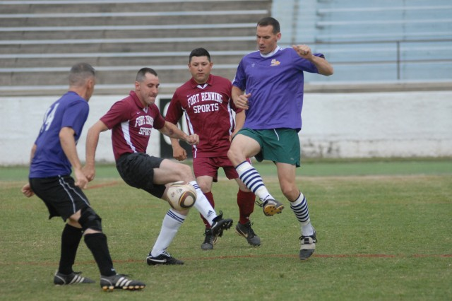 The Internationals' Ray Shisler, far left, and Aaron Angel, far right, battle with Rock Force's Byron Braswell, left middle, and Jose Ballejo, right middle, for the ball Monday at Doughboy Stadium.  The Internationals defeated Rock Force 1-0 in overtime.