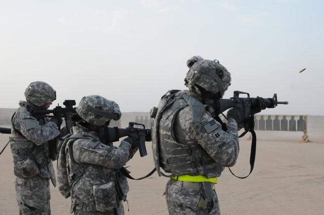 Soldiers from the 3rd Sustainment Brigade fire off rounds to test their weapons in Kuwait before heading up to Balad, Iraq to take over their year-long mission of drawing down troops and equipment from Iraq.