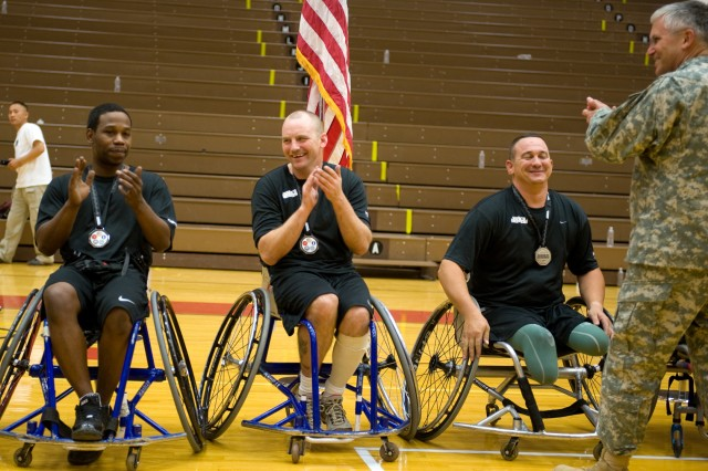 Gen. George W. Casey Jr., Army Chief of Staff, applauds the Army's wheelchair basketball team after presenting them Silver medals during the Warrior Games at Colorado Springs, Colo., May 13. Some 200 wounded active-duty members and military veterans competed in the inaugural Warrior Games May 10-14.