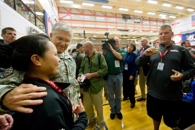 Gen. George W. Casey Jr., Army Chief of Staff, takes a picture with a Soldier athlete participating in the Warrior Games at Colorado Springs, Colo., May 13. Some 200 wounded active-duty members and military veterans competed in the inaugural Warrior Games May 10-14.