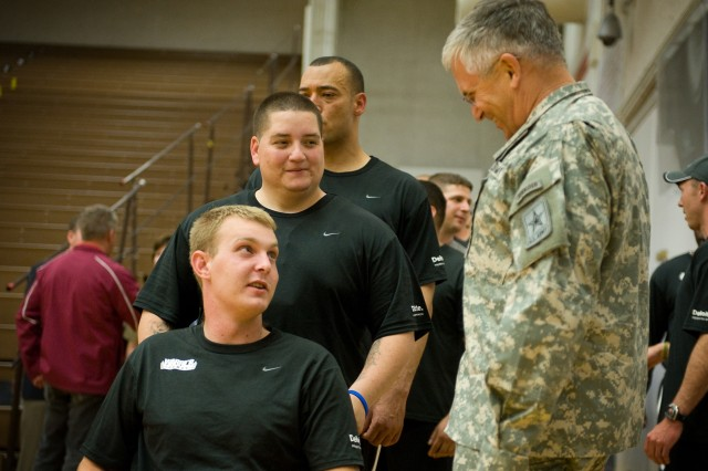 Army Wheelchair basketball players talk with Gen. George W. Casey Jr., Army Chief of Staff, during the Warrior Games at Colorado Springs, Colo., May 13. Some 200 wounded active-duty members and military veterans competed in the inaugural Warrior Games May 10-14.