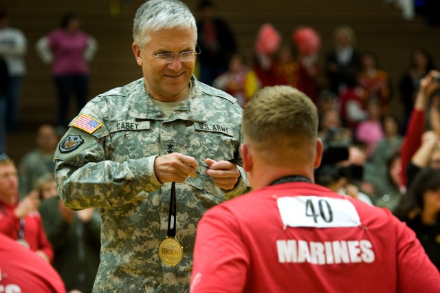 Gen. George W. Casey Jr., Army Chief of Staff, awards Gold medals to the Marine wheelchair basketball team at the Warrior Games in Colorado Springs, Colo., May 13. Some 200 wounded active-duty members and military veterans competed in the inaugural Warrior Games May 10-14.