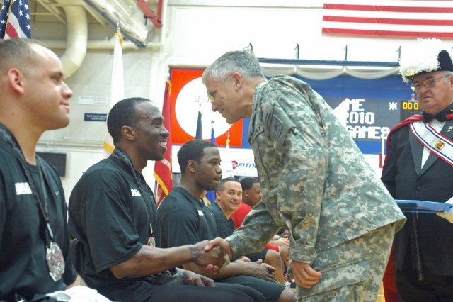 "Army Chief of Staff Gen. George W. Casey Jr. presents silver medals to the Army wheelchair basketball team during his surprise visit to the Warrior Games Thursday. ""What I saw in their faces was absolute pride to be out here,"" he said about all the athletes."