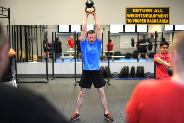 1st Sgt. Timothy Overbey works out at McVeigh Sports and Fitness Center's new CrossFit room.