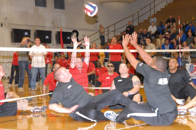 Army's team (foreground) battles the Marines in the sitting volleyball championship Thursday night at the Warrior Games in Colorado Springs, Colo. The Soldiers lost a tie-breaker to settle for silver.