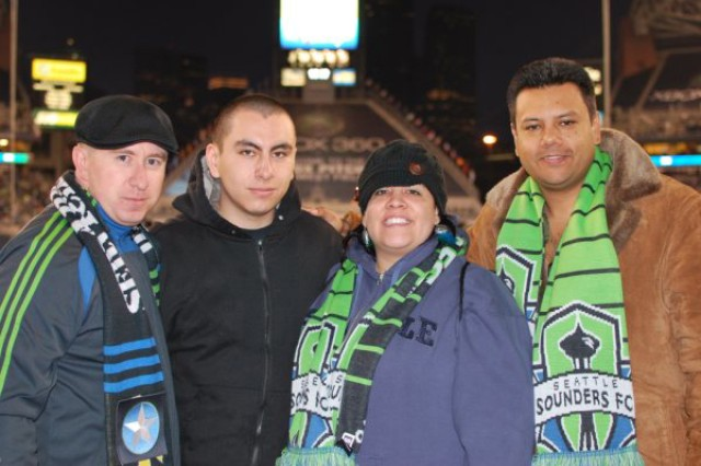 At the Seattle Sounders match are, from left, Matt Goecks of the ASG and WTB Soldiers Edwin Hurtado, April Miranda and Gustavo Rivera.