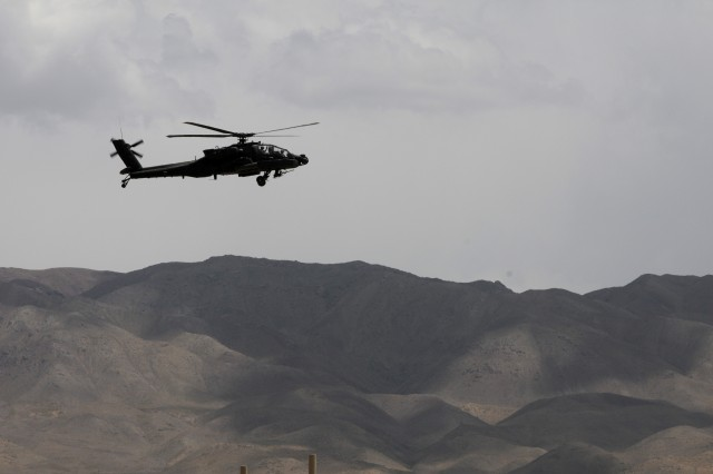 A 101st Combat Aviation Brigade, Task Force Destiny AH-64 Apache helicopter flies through the mountains of Afghanistan in Shinkai, Afghanistan, May 7, 2010. PHOTO BY SADIE E. BLEISTEIN www.facebook.com/101cab