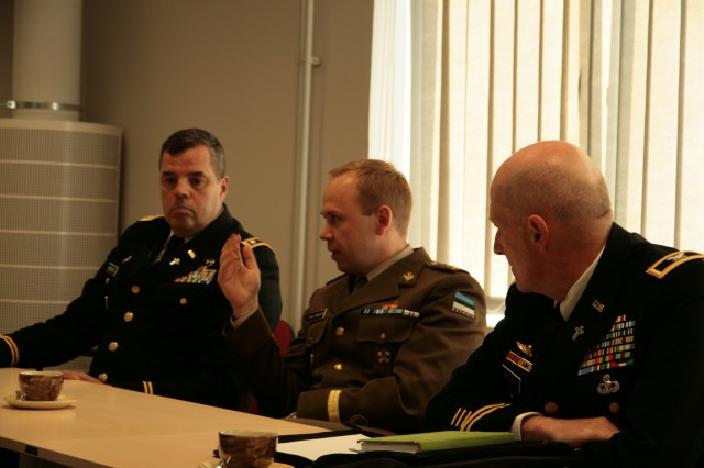 """Col. Ray Bailey, Command Chaplain U.S. Army Europe (right) and Lt. Col. Taavi Laanepere, Chief of Chaplains Estonia Defence Force (center) listen to discussions on religious support issues of the Estonian military chaplaincy in Tapa, Estonia, May 13, 2010.  Several chaplains from U.S. Army Europe and the Estonia Defence Force were in attendance at the meetings. This is the U.S. Army Europe Command Chaplain's first visit with the Estonian Chief of Chaplains. The U.S. Army Europe Chaplain's Office conducted the visit with the Estonian Defence Force chaplains to build partnerships between the land forces components of the two nations. The Estonian Military Chaplaincy was restored in 1996. This year the U.S. Army Chaplain Corps celebrates its 235th year of service as a branch. (U.S. Army photo)"""""""