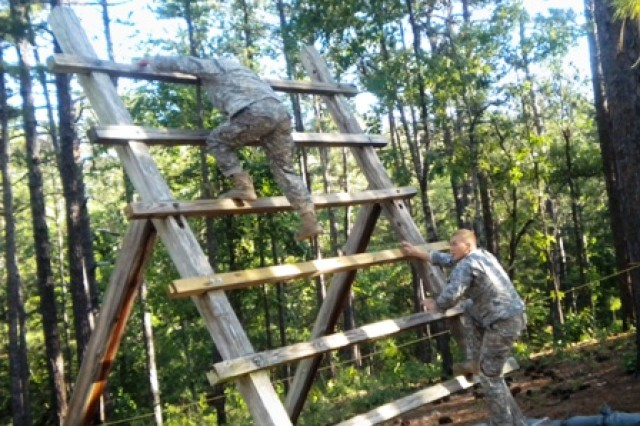 1st. Lt. Matt Schachman (top) and Capt. John Campbell, both of 2-27 Infantry Battalion, 3rd Brigade Combat Team, represent 25th Infantry Division in the Best Ranger Competition at Fort Benning, Ga., May 8, 2010.