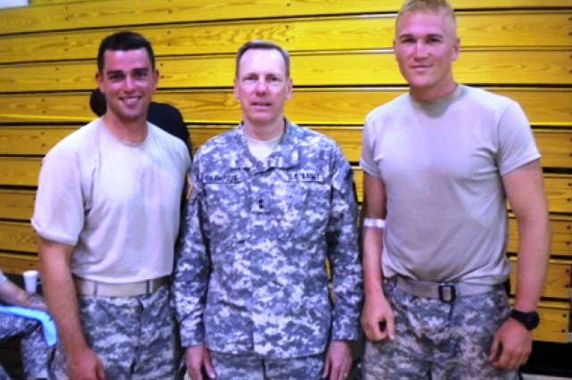 Maj. Gen. Bernard Champoux (center), commanding general, 25th Infantry Division, stands with 1st. Lt. Matt Schachman (left) and Capt. John Campbell, both of 2-27 Infantry Battalion, 3rd Brigade Combat Team, after they completed the Best Ranger Competition at Fort Benning, Ga., May 9, 2010.