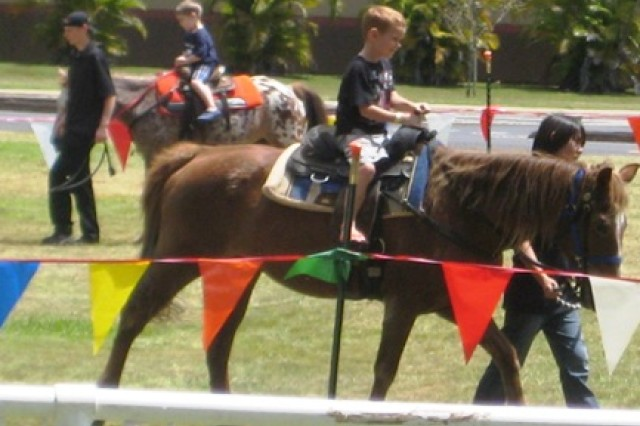 Riding horses at Sills Field, Schofield Barracks, Hawaii, May 15, 2010.