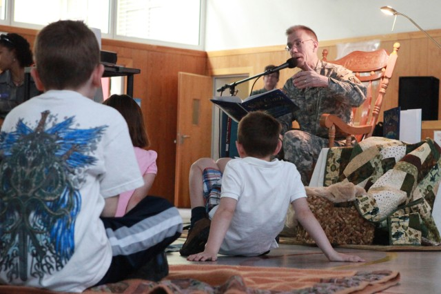 "MANNHEIM, Germany (May 16, 2010) -- Brig. Gen. Jeffrey G. Smith, commander, 5th Signal Command, and senior mission commander for Mannheim, reads ""Night Catch"" by Brenda Ehrmantraut, during the Tell Me A Story event held at the Mannheim Elementary School gym on Sullivan Barracks. ""Night Catch"" tells the story of a father and his son playing a nightly game of catch using the North Star. (Photo by Jonathon M. Gray, 5th Signal Command)(released)"