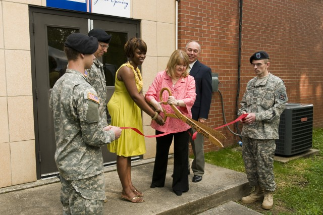Laura Stultz (right), wife of Lt. Gen. Jack C. Stultz, chief, Army Reserve, cuts the ceremonial ribbon during the grand opening of the Army Reserve's Army Strong Community Center located in Brevard, N.C., May 15.