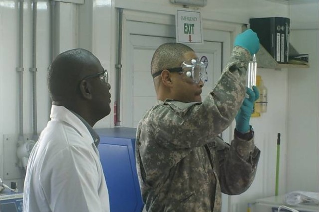 Sgt First Class Alexander Haynes tests fuel at Forward Operating Base Frontenac, Afghanistan.  Haynes was awarded the 2009 API Award for Tactical Petroleum Soldier of the Year.  Haynes is assigned to the 49th Quartermaster Group, Fort Lee, Va.  (Courtesy Photo)