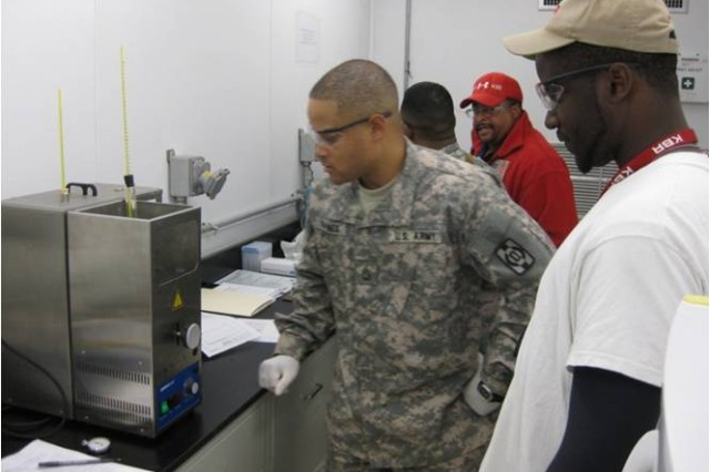 Sgt First Class Alexander Haynes analyzes fuel samples at Victory Base Complex, Iraq.  Haynes was awarded the 2009 API Award for Tactical Petroleum Soldier of the Year.  Haynes is assigned to the 49th Quartermaster Group, Fort Lee, Va.  (Courtesy Photo)