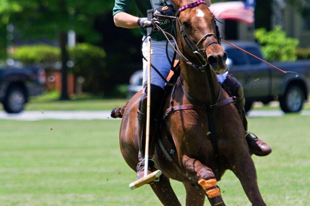 Army polo team member, Joe Meyer, turns his horse around to get involved in the game.