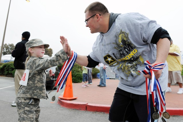 PRESIDIO OF MONTEREY, Calif. - Over 140 participants took part in the Family Fun Fitness Festival on Ord Miltary Community May 15. OMC families walked or ran an approximately two-mile course around the new Doe Park housing area and were greeted with medals and certificates noting their accomplishment of the event.