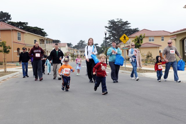 PRESIDIO OF MONTEREY, Calif. - Over 140 participants took part in the Family Fun Fitness Festival on Ord Miltary Community May 15. OMC families walked or ran an approximately two-mile course around the new Doe Park housing area with stations featuring free products from sponsors.